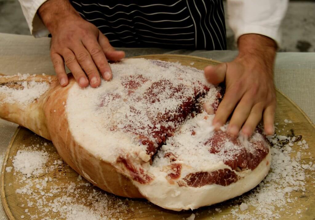 Salting prosciutto